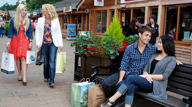 Four people shopping at Trentham Shopping Village