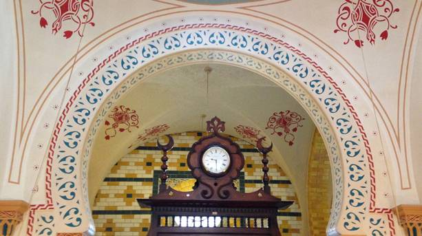 Archway with clock in Turkish Baths