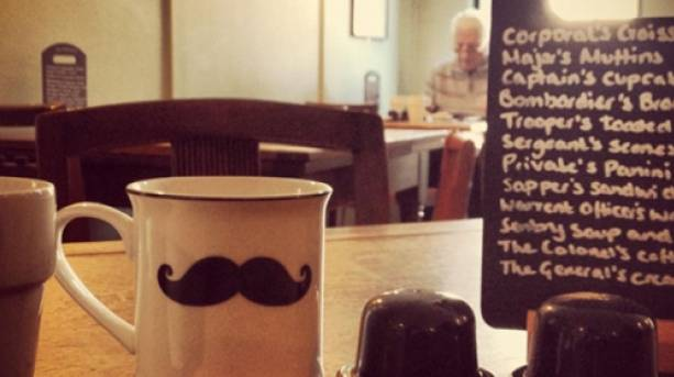 A mug with a moustache in a vintage café