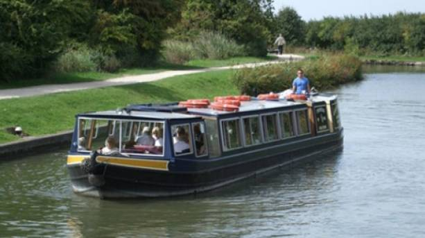 Covered boat on the Grand Union Canal, Buckinghamshire
