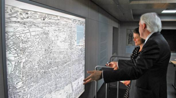 Visitors looking at the 'Agas' map of London at the Heritage Gallery in London, England