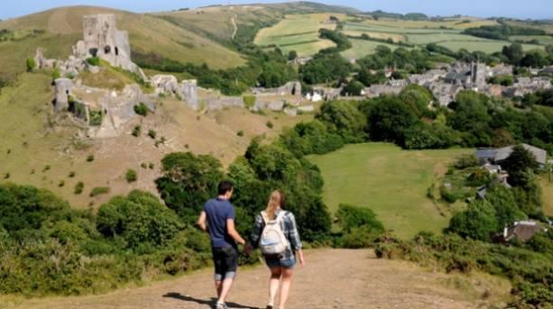 Walkers at Corfe Castle in Dorset, England