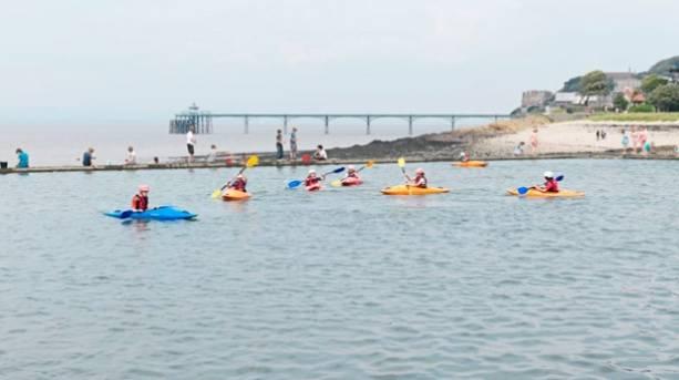 Children kayaking on Marine Lake Clevedon