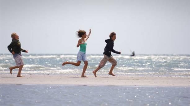 Children running on the Witterings Beach