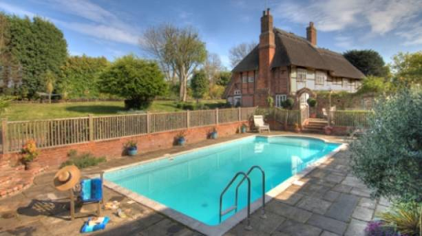 An outdoor swimming pool at The Manor Farmhouse, Kent