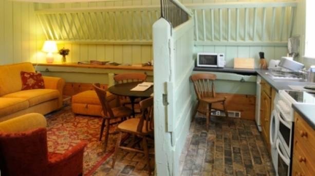 A kitchen and lounge at Brackenborough Hall Coach House in Lincolnshire