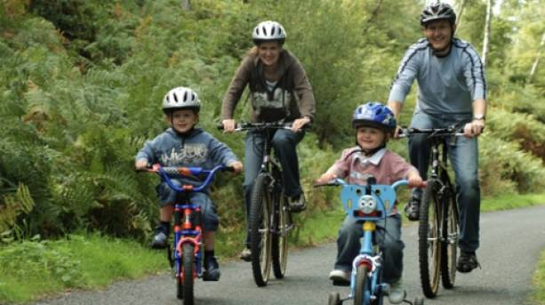 A family enjoying the family cycle trail