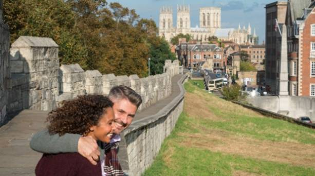 A couple sitting on the city walls of York