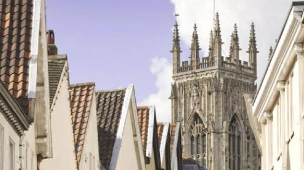 Rooftops on Low Petergate under York Minster