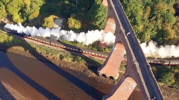 North Yorkshire Moors Railway steams under Larpool Viaduct
