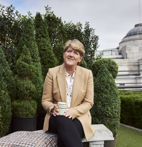 Clare Balding sitting in the rooftop garden at Coq d'Argent