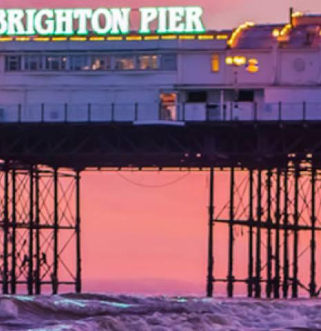 Brighton Pier, Brighton, East Sussex, England at sunset.