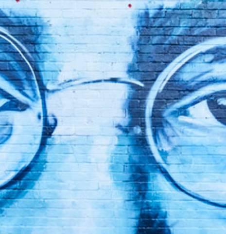 Large John Lennon mural on brick wall in Bold Street, Liverpool, Merseyside, UK.