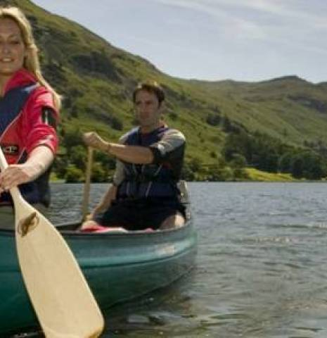 Two people canoeing in the Lake District, Cumbria