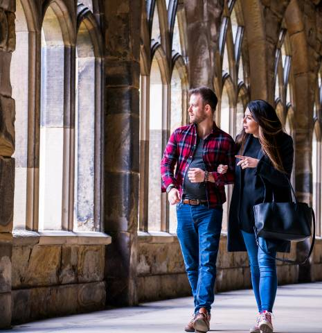 Couple wandering the cloisters at Durham Cathedral