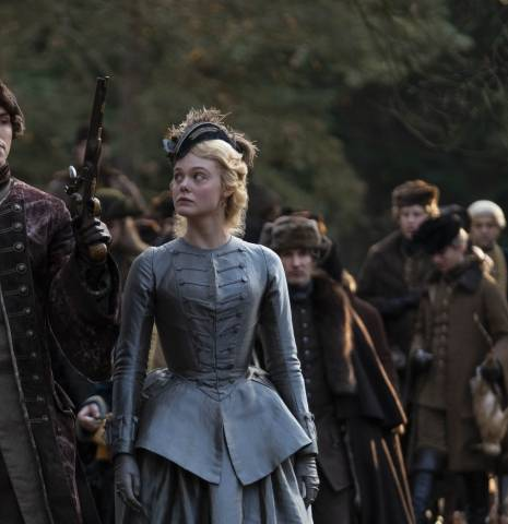 Nicholas Hoult and Elle Fanning walking through the woods on The Great