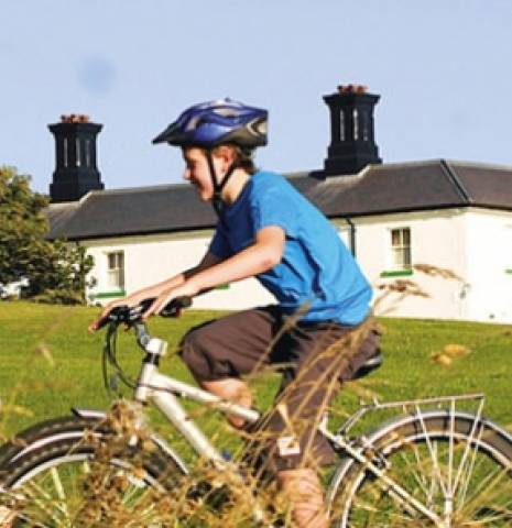 A family cycling past Souter Lighthouse on Tyneside