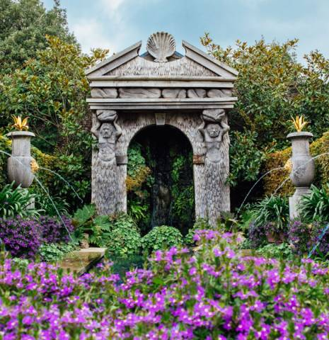 Earl's Court Garden with urn water features and arch, Arundel Castle, Arundel, West Sussex, England.