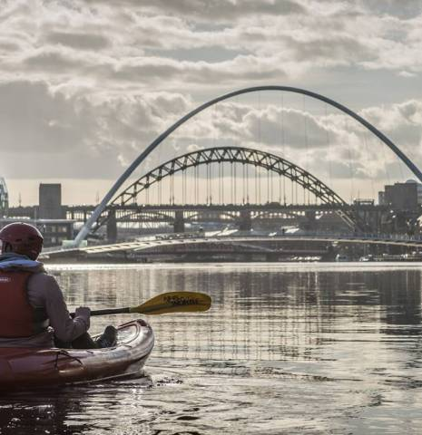Two men kayaking on the River Tyne