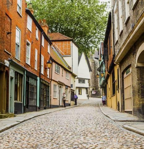 Couple walking down Elm Hill in Norwich