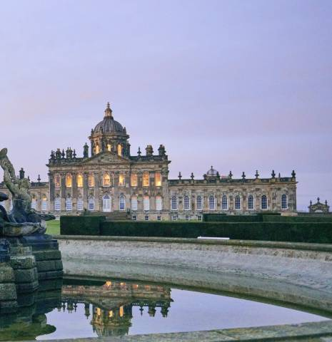 A fountain in the gardens of Castle Howard, Yorkshire, the castle in the distance.