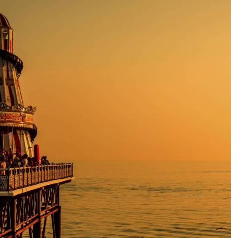 Brighton Pier in the evening sunset glow, Brighton, East Sussex, England.