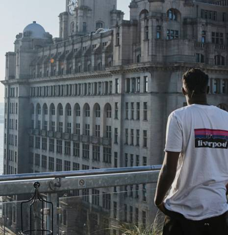 A man looks out over Liverpool.