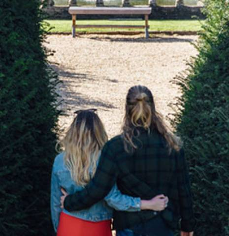 Couple hugging in the gardens of Sudeley Castle & Gardens, Gloucestershire, England.