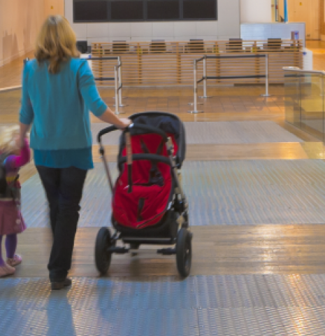 A family entering the Science Museum in London through step free access.