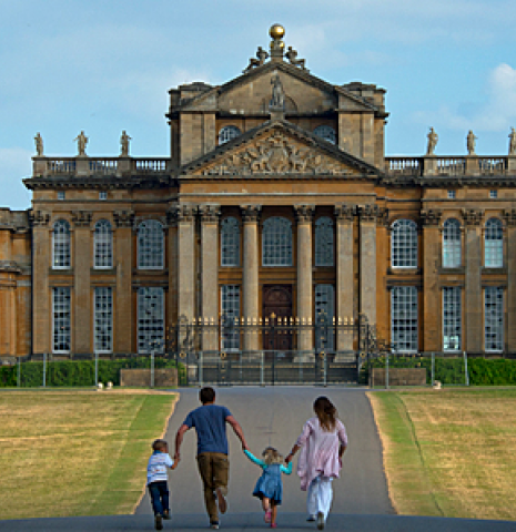 A family walking down a path towards Blenheim Palace, Oxfordshire.
