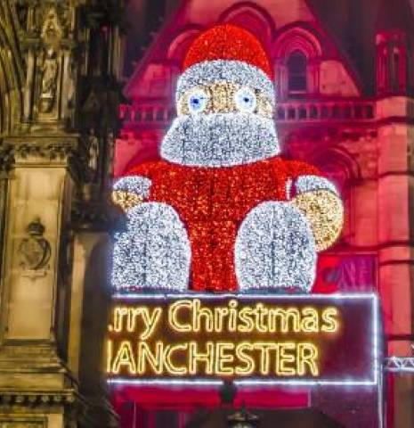 Manchester Town Hall illuminated at Christmas, Greater Manchester, England.