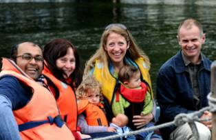 Family taking a boat trip on the River Thames