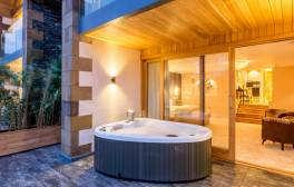 Cosy up in a private hot tub on a romantic retreat