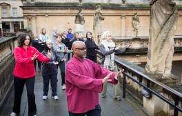 Practise Tai Chi overlooking the magnificent Roman Baths