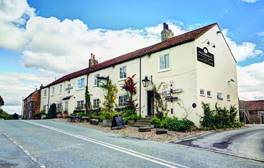 Stay in a 300-year-old pub in the heart of Herriot country