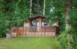 Relax in a hot tub surrounded by nature at Woodland Holiday Park