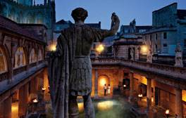 Explore the magical Roman Baths by torchlight