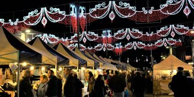 People browsing the stalls at Stratford-upon-Avon's Christmas market