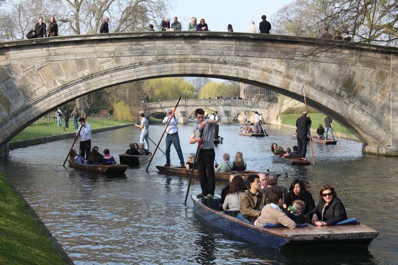 visitors punt on Cambridge's famous river