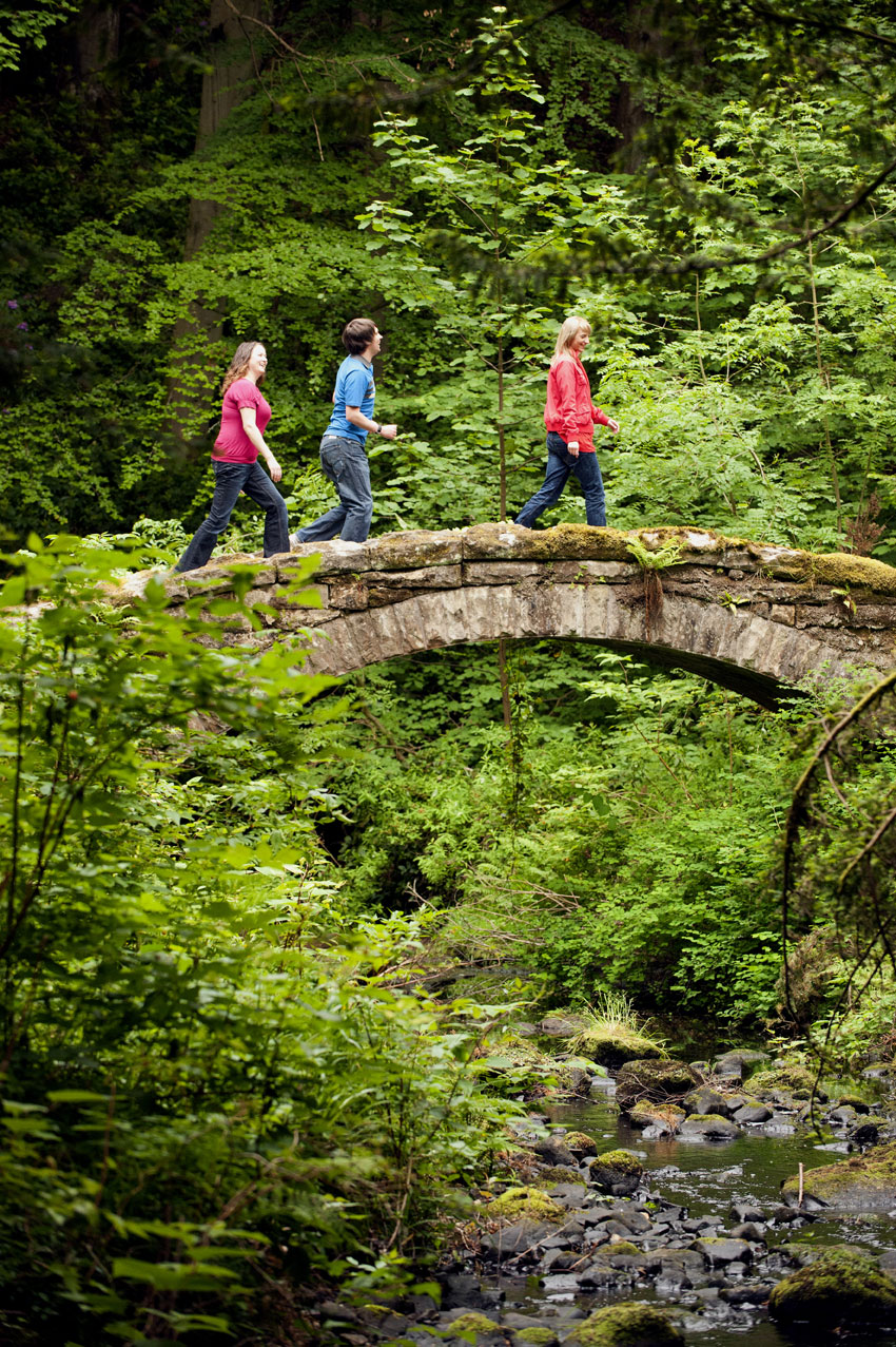 Visitors on a stone bridge at Cragside, Northumberland © NT Images John Millar