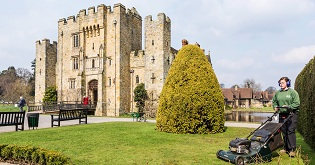 A gardener mowing the lawn outside Hever Castle (c) Alex Hare