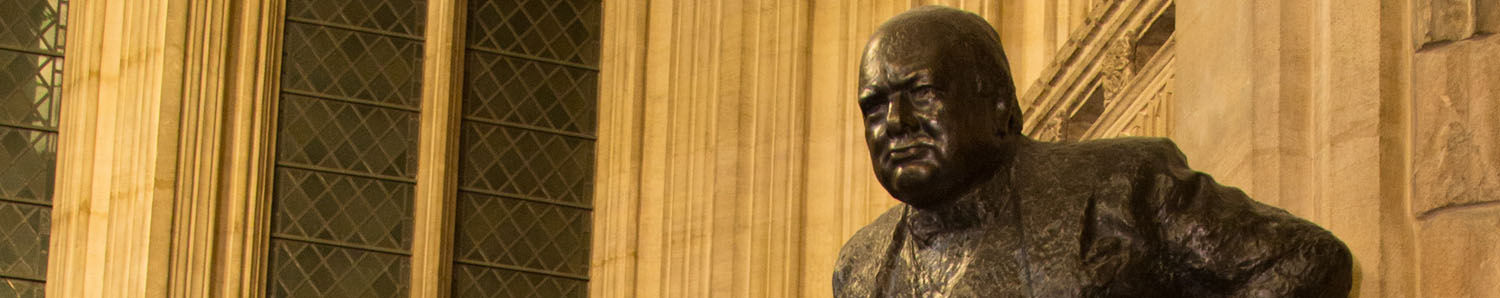 A statue of Winston Churchill in the Houses of Parliament