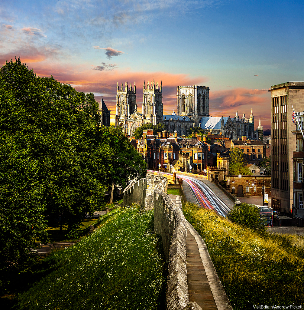 The centre of York, surrounded by walls whose foundations date back to medieval times. There is a wall walk around the city. York Minster at sunset.